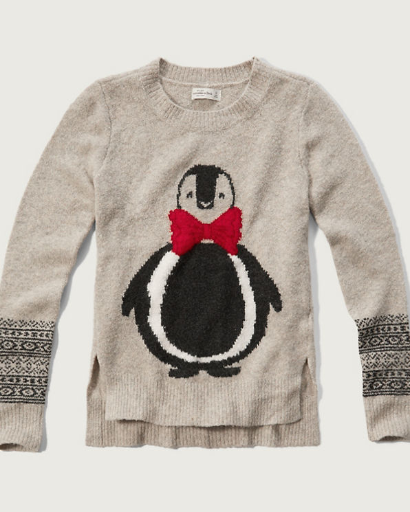This Christmas Penguin jumper is perfect for keeping warm this winter season and getting into the festive spirit. Team this look with a warm scarf and cosy gloves.