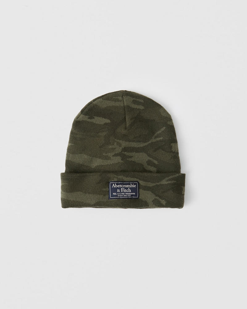 f2361fa2ba7 product image. Product Details. Soft beanie in a camo print with turn-up  detail and logo ...