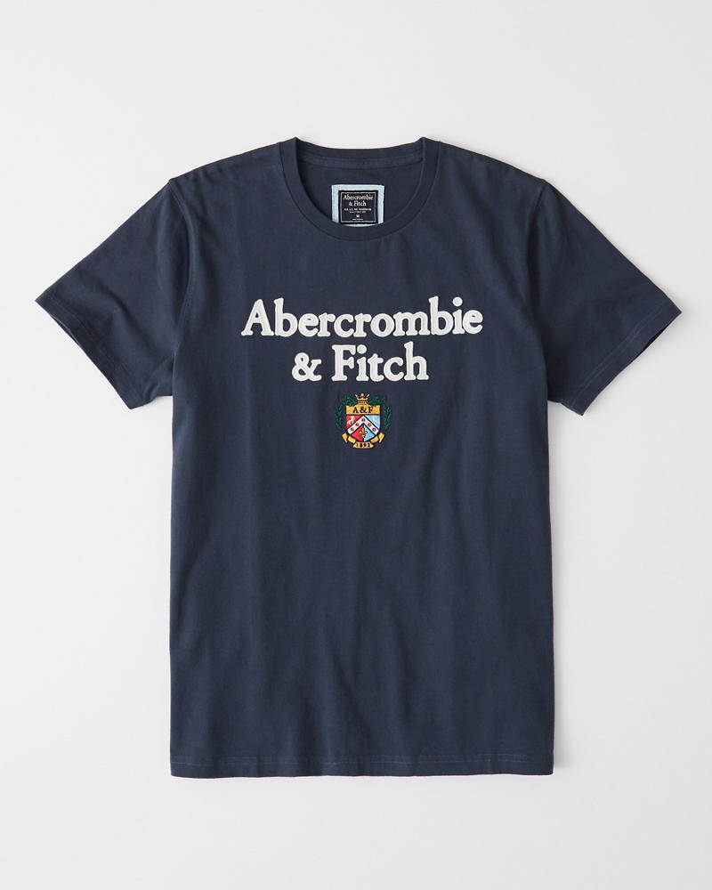 6fc9da3a4 Hombre Camiseta con cuello redondo y logo con insignia