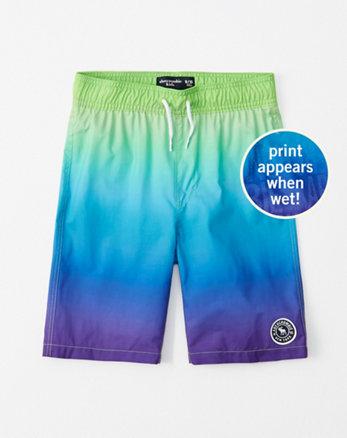 961d6a8c49 boys swimwear. pattern-changing boardshorts, purple ombre magic pattern ...