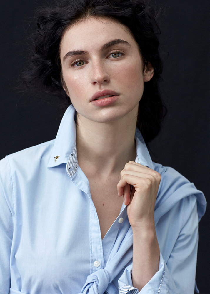 woman in a collar studs button up shirt