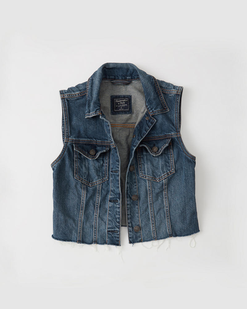 Product Features Classic denim vest with mini flip pockets in the front and buttons down.